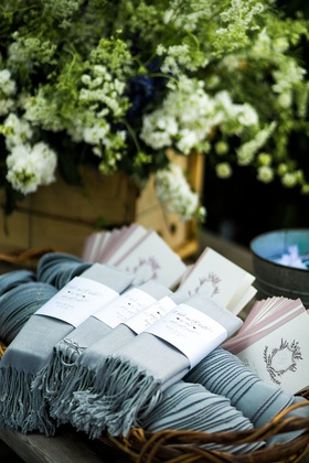 wedding ceremony favors ceremony programs and custom labels on light blue pashmina shawl