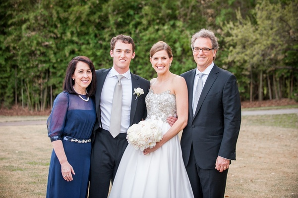 Newlyweds with mother-of-the-groom and father