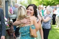 Shelly Bartels hugging guest at wedding cocktail hour