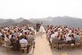 Beautiful views mountain canyon malibu wedding ideas helipad stone brick wood chairs guests watching