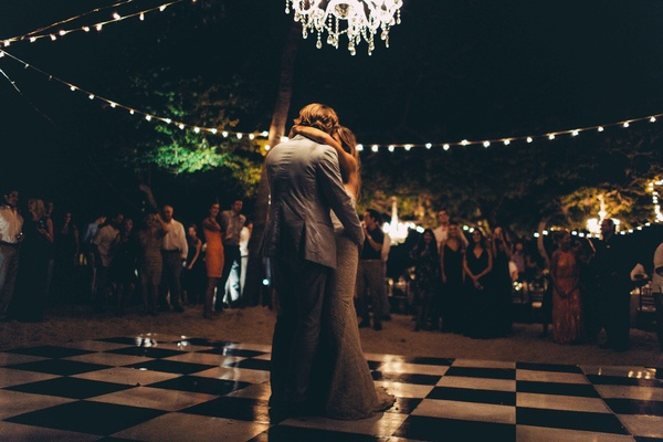 newlywed first dance night time beach punta mita mexico destination wedding dark fairy lights