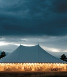 Evening ranch wedding location with large white tent