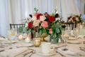 red blush ivory roses with eucalyptus and greenery, gold bowl