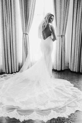 black and white photo of bride in galia lahav, open back, dramatic train