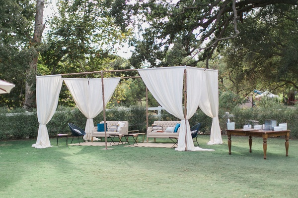 wooden structure over lounge area california winter wedding styled shoot brookview ranch rustic