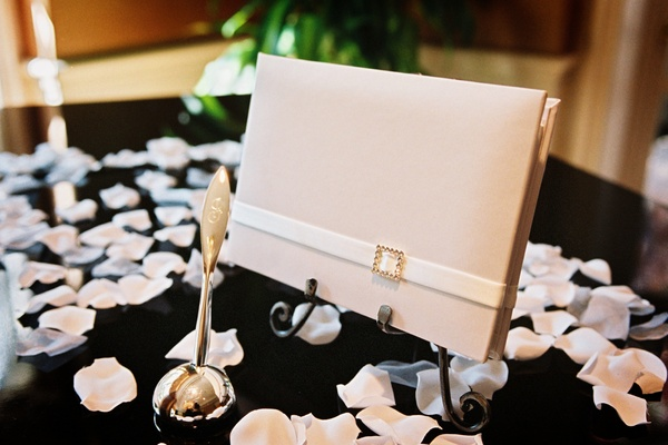 Gold ball pen with ivory guestbook on stand