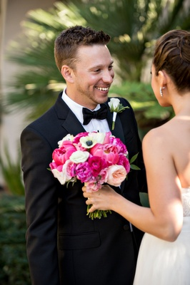 Groom smiles at bride during First Look before wedding ceremony