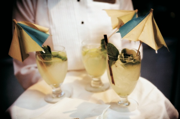 Wedding drinks with blue and yellow cocktail umbrellas