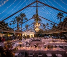 Wedding reception la quinta resort & spa outdoor wedding fairy lights in tent formation chandelier