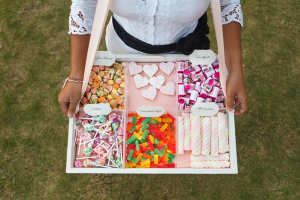 Servers passed candy on old-fashioned trays
