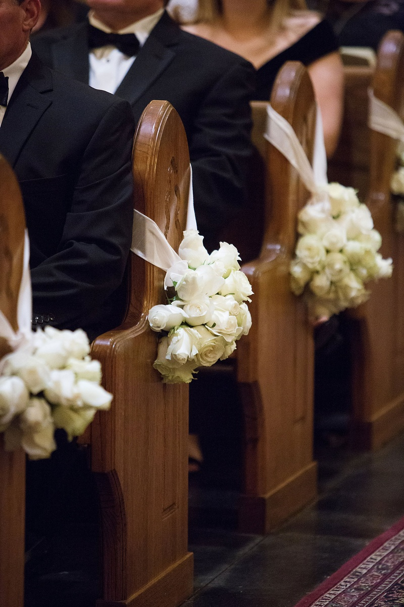 Ceremony Décor Photos - White Roses on Church Pews - Inside Weddings