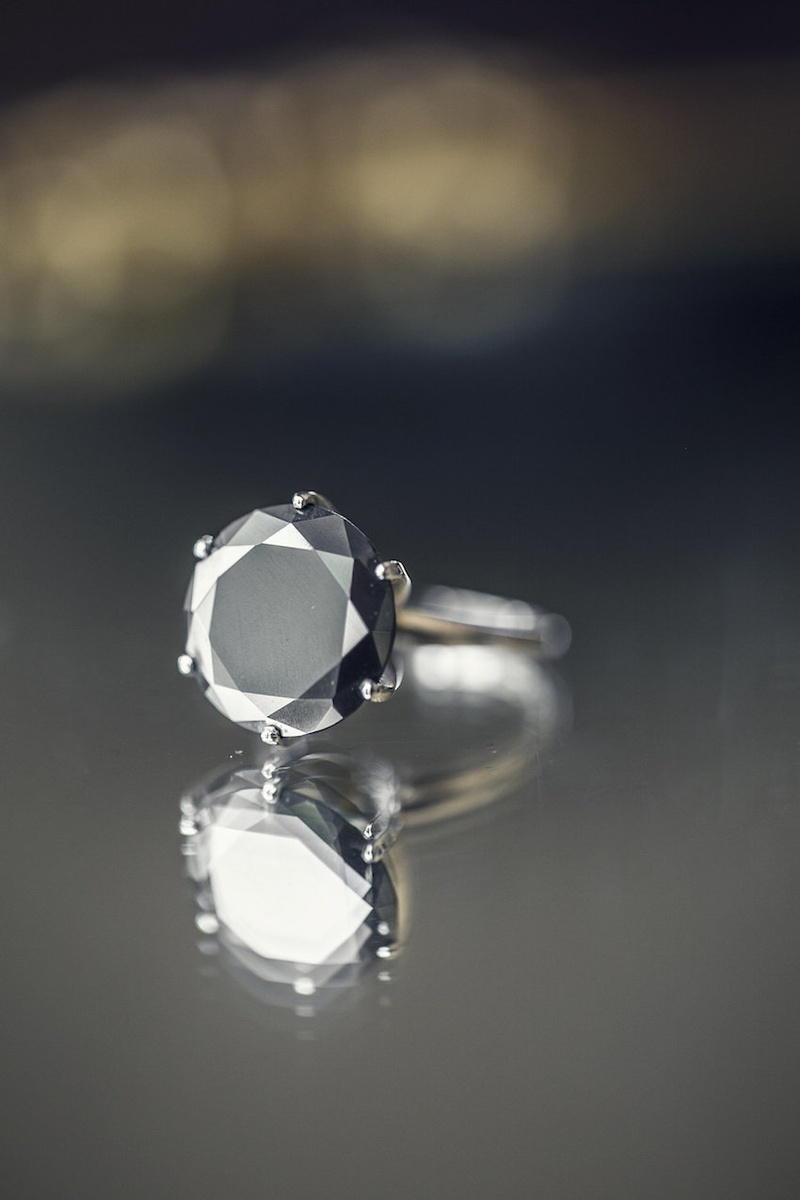 Bride's engagement ring with a round black diamond