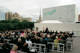 Guests watch wedding ceremony outside of Minneapolis art museum