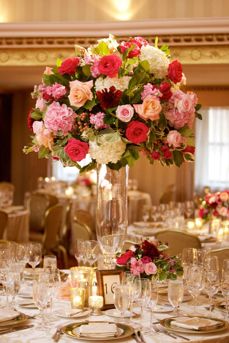 Wedding reception ballroom centerpiece tall hydrangea rose flower arrangement frame table number