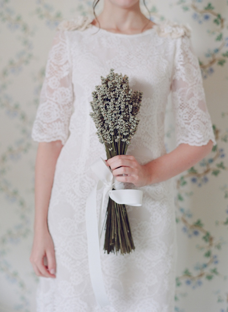 Bridesmaid in lace dress holding white lavender bundle