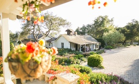 Intimate wedding cocktail hour on the porch of the adobe at San Ysidro Ranch