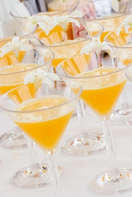 Tropical alcoholic drink with orchid garnish