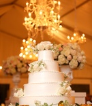 white wedding cake, flower-embellished cake