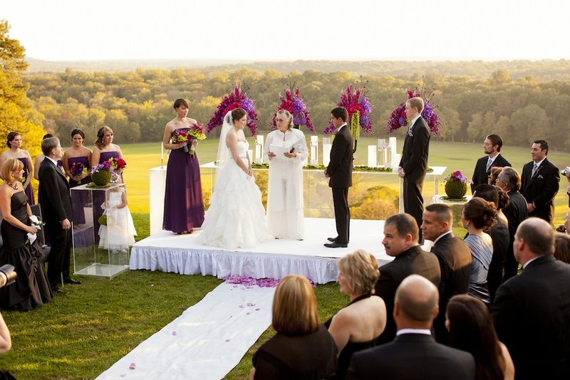 Female officiant at outdoor landscape wedding