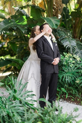 bride covers grooms eyes first look florida wedding beaded gown surprise traditions new trend before