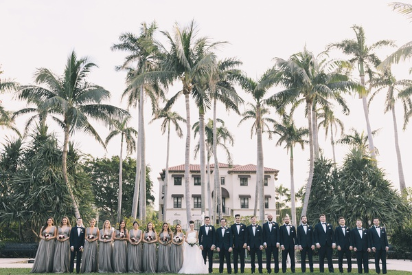 Henry Morrison Flagler Museum wedding,large bridal party in front of palm trees