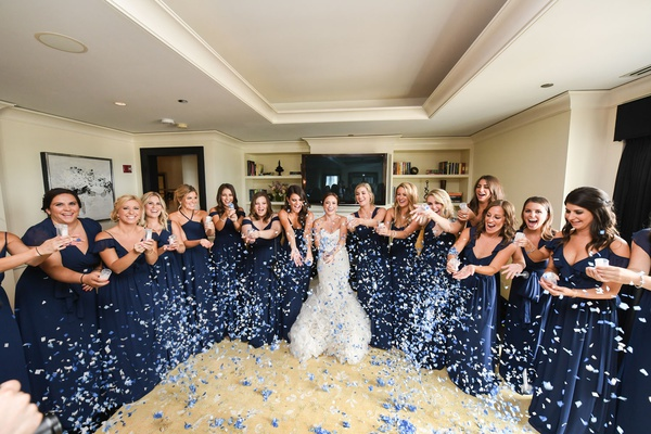 wedding photo bride in mermaid wedding dress bridesmaids in navy blue gowns confetti canons