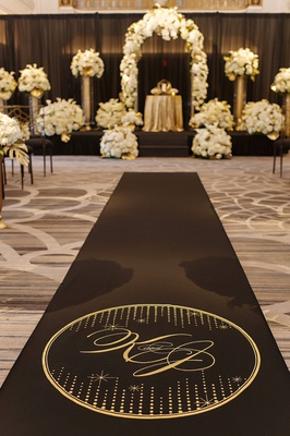 black aisle with gold logo and monogram, aisle runner by original runner company
