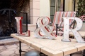 silver and red light up marquee letters in bride and groom's initials, ampersand