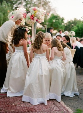 White and ivory dresses with bows