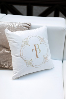 wedding reception lounge area with pillow printed with custom monogram from ceci new york
