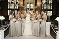 Gold metallic bridesmaid gowns at ceremony