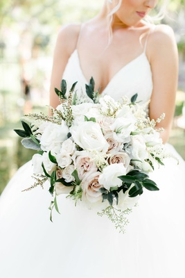 dark greenery and soft dusty miller, large white flowers, very pale blush roses
