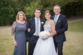 Newlyweds with mother-of-the-bride and father-of-the-bride