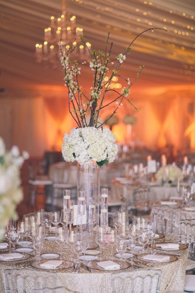 Sequined linens topped with floating candles