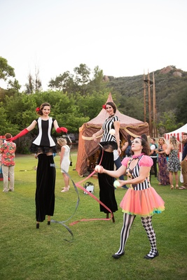 Tents and stilt walker juggler at wedding reception Malibu CJ Lana Perry's circus theme wedding