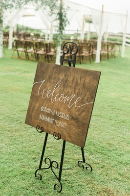 Wood welcome sign on wrought iron easel outdoor wedding ceremony reception montage kapalua bay