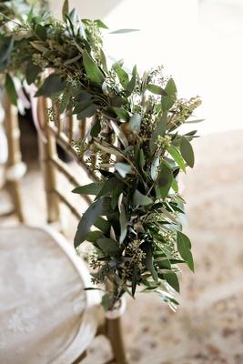 eucalyptus garland on back of gold chiavari chair, wedding sweetheart table