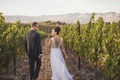 Groom in suit and bride in low v-back Mira Zwillinger wedding dress from Carine's Bridal Atelier