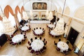 wedding reception overhead view round tables gold chandeliers painting drapery art deco feel