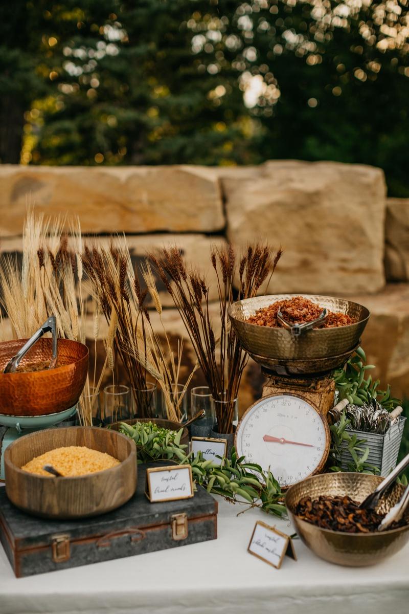 wedding reception outdoor garden wedding ideas fall late summer hammer wood bronze bowls calligraphy