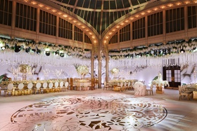 wedding reception new york public library gold design on large dance floor roses hanging from arches