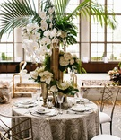wedding reception styled moroccan wedding shoot pattern linen gold chair white flower palm greenery
