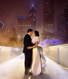 Bride in a Carolina Herrera gown with bustle train with groom in tuxedo in Chicago