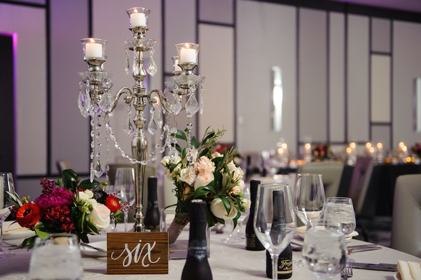Metallic candelabrum with garlands of crystals