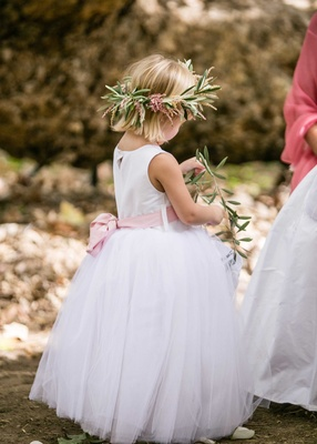 Flower girl with pink bow sash flower crown of olive leaves and pink flowers