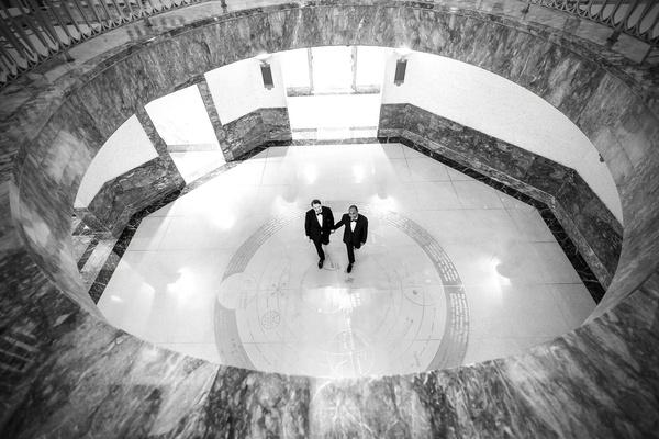 black and white photo of grooms in tuxedos at harold washington library gay lgbt wedding ideas
