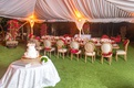 wedding reception acqualina resort and spa tent reception long head table pink red flowers