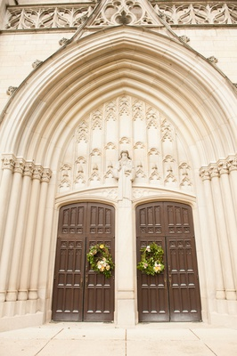 wedding ceremony venue in indiana presbyterian church arch tall brown wood doors wreaths
