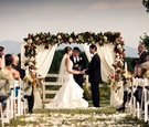Bride and groom at alfresco wedding ceremony