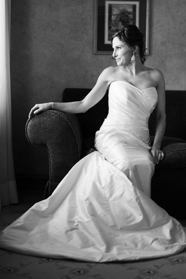 Black and white photo of a bride in a strapless Romona Keveza dress